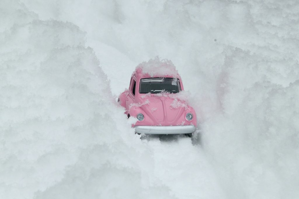 Pink VW Beetle almost buried in snow